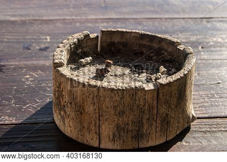 Wooden Ash Tray With Cigarette Butt Closeup