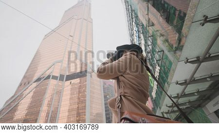 Beautiful Woman Takes Urban Winter Landscape. Action. Stylish Woman Shoots Urban Landscapes On Profe