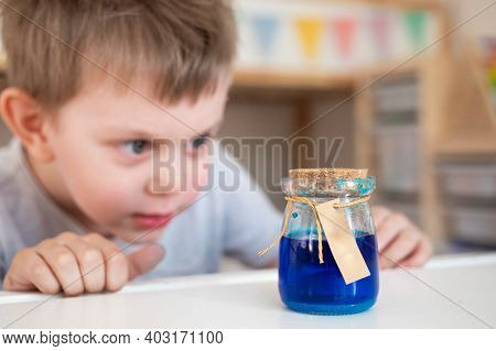 Toddler Boy Making Chemistry Scientific Experiments, Watching The Experiment Going. Smart Preschoole