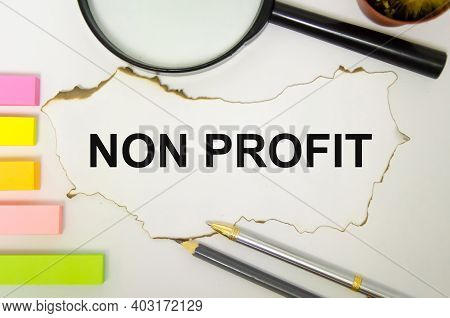 The Word Non Profit Written On A White Sheet Of Paper Which Lies On A White Background Lie Next To A