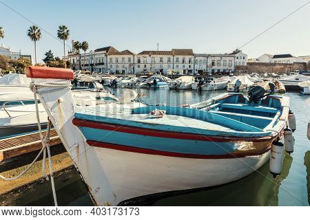 Old Town Of Faro With Traditional Wooden Boat Moored In Marina, Portugal