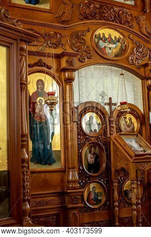 Wooden Altar With Icons. Carved Frames And Doors Of The Altar And Iconostasis