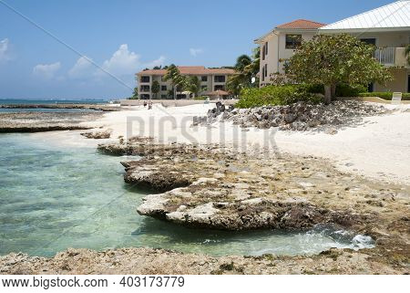 The Rocky Landscape And Transparent Waters On Grand Cayman Seven Mile Beach (cayman Islands).