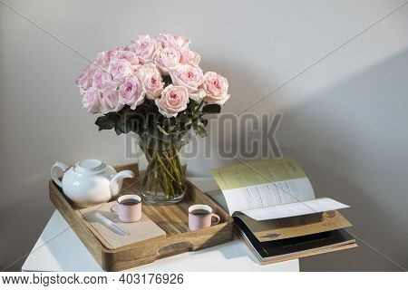 Rose White Pink O'hara. Bouquet Of Pink Roses In A Glass Vase With A White Teapot And Two Cappuccino