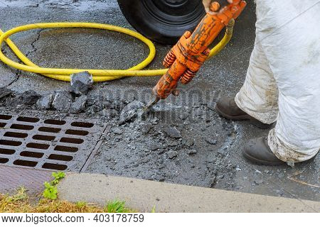Jackhammer With A Pneumatic Drill Perforating The Asphalt Of An Urban Road Being Renovated On A Stre