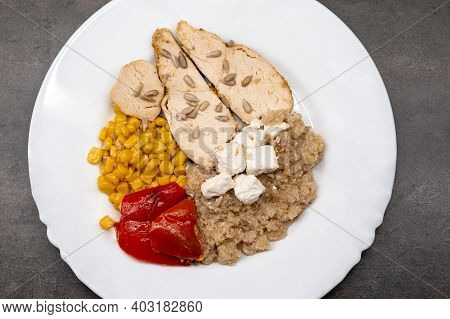 Chicken Salad, Grilled Corn, Quinoi, Roasted Peppers And Feta. Healthy Food Served On A White Plate.