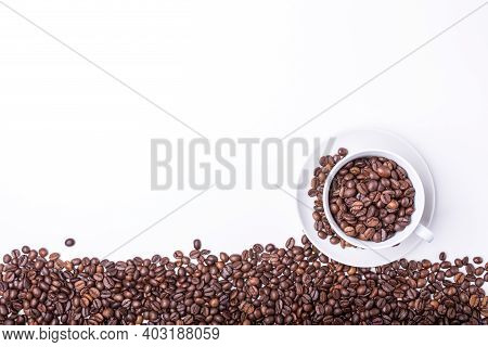 Top View Of White Cup Filled With Freshly Roasted Coffee Beans