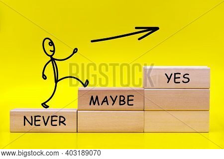 Figure Of A Little Man Running To By Stacked In The Form Of A Ladder Wooden Blocks With Words Never