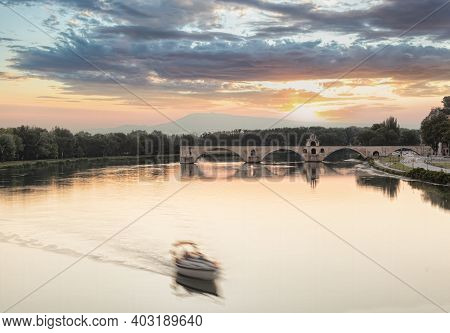 Avignon, Famous Bridge With Rhone River Against Sunset In Provence, France