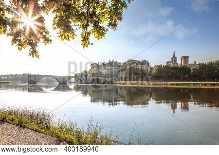 Avignon, Palace Of Popes With Famous Bridge During Evening In Provence, France