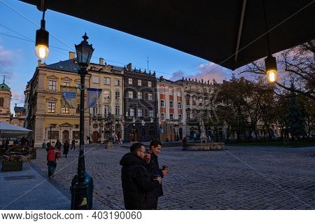 Lviv, Ukraine - November 5, 2020: People Walk On The Market Square