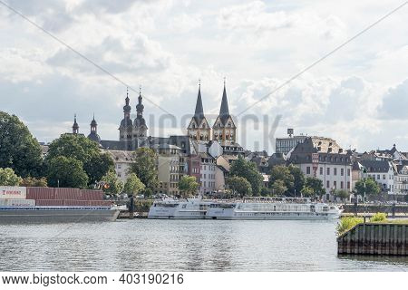 Koblenz, Germany - Aug 1, 2020:overview Of Florinskirche Church By Mosel River In Summer
