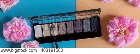 Set Of Pastel Eyeshadows Isolated On Blue Orange Background. Eyeshadow Of Nude Shade.eyeshadow Cosme