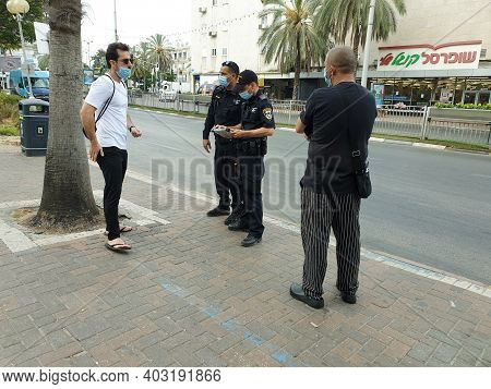 Holon, Israel. July 6, 2020. Israeli Police Officers Giving Out Fine Reports To Israelis Without Pro