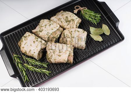 Marinated Chicken Thigh On A Grill Pan On A Light Background. Chicken For Retail.precooked Food.conv