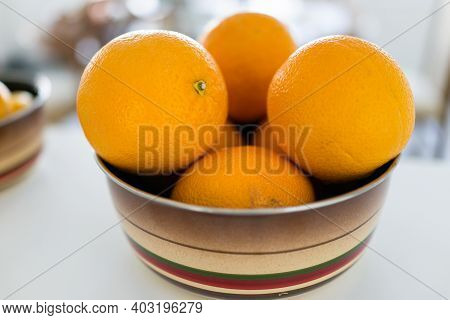 A Bowl Of Oranges On The Table. High Quality Photo