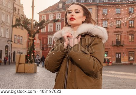 Elegant Girl Walk In A Winter City. Beautiful Lady With Blond Hair. Portrait Of Beautiful Blond Woma