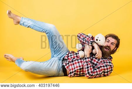 Being Playful. Male Feel Playful With Bear. Brutal Mature Hipster Man Play With Toy. Happy Birthday.