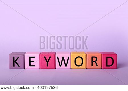 Colorful Cubes With Word Keyword On Lilac Background