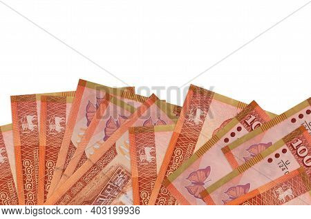 100 Sri Lankan Rupees Bills Lies On Bottom Side Of Screen Isolated On White Background With Copy Spa