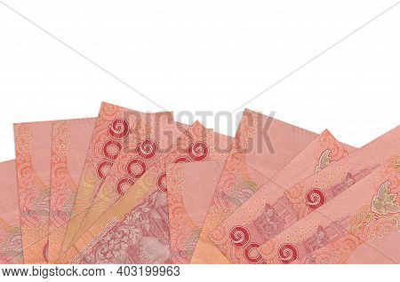 100 Thai Baht Bills Lies On Bottom Side Of Screen Isolated On White Background With Copy Space. Back