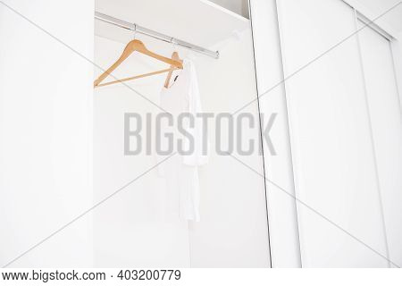 Wardrobe With Empty Ramps. Sale In The Store. Emptiness.modern Wardrobe With One White T-shirt And E