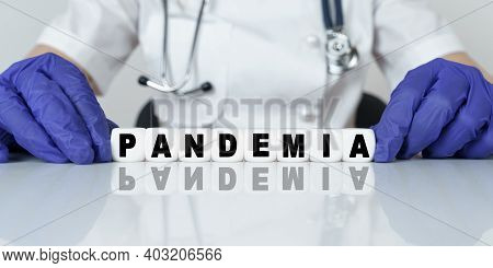 Medicine And Health Concept. The Doctor Put Together A Word From Cubes Pandemia