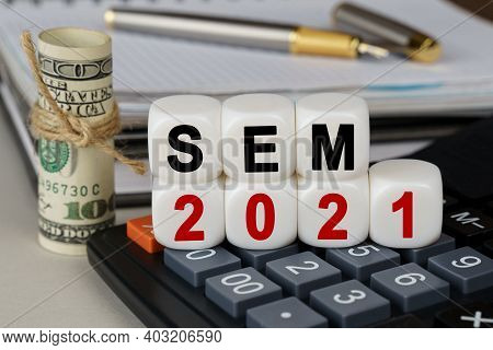 Business And Finance Concept. There Are Cubes On The Calculator That Say - Sem 2021. Nearby Out Of F