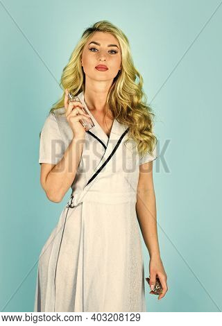 Great Fragrance. Gorgeous Girl With Curly Hair. Hair Oil Spray. Beauty And Fashion. Shop Assistant O