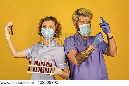 Creating Vaccine. Medical Professional Workers Colleagues. Medical Couple Testing Tubes Vaccination.