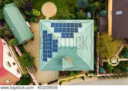 Aerial View Of A Rural Private House With Solar Photovoltaic Panels For Producing Clean Electricity