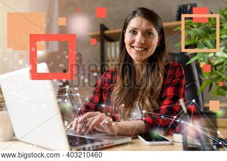 Woman Surfs In Internet With Her Laptop. She Work At Home As Smart Working
