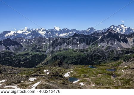 High Altitude Landscape In Alps With The View Of Barre Des Ecrins And La Meije In The Distance.