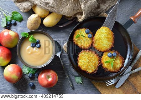 Crunchy Fried Potato Pancakes Served With Sweet Applesauce And Some Berries