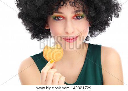 Funky woman eating cookie