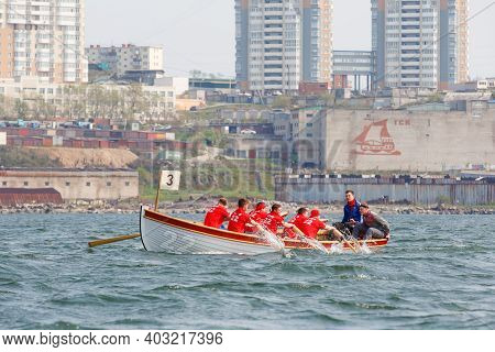 Vladivostok, Russia - 2020, Summer - Maritime Competition By A Cadet Of The Naval School In Rowing O