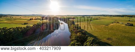 Sun Setting Over Snowy River Bend And Green Fields - Wide Aerial Panoramic Banner