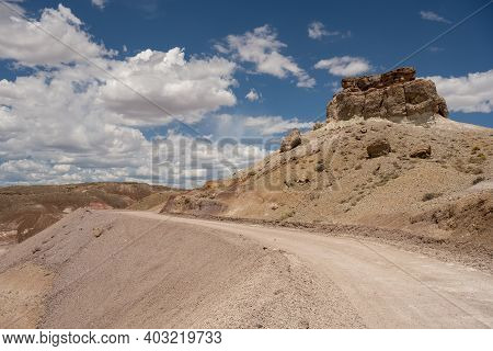 Dirt Road Through Desert In Utah's Capitol Reef National Park