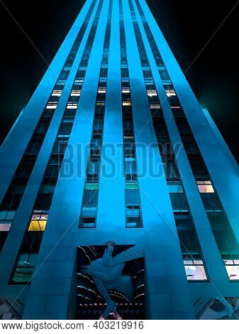 The Rockefeller Center in Midtown Manhattan from a close low perspective at night. LED lights were changing color. 1/14/2021