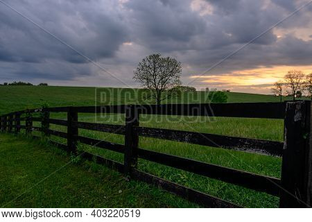 Early Morning Horse Fence In Front Of Cloudy Sunrise