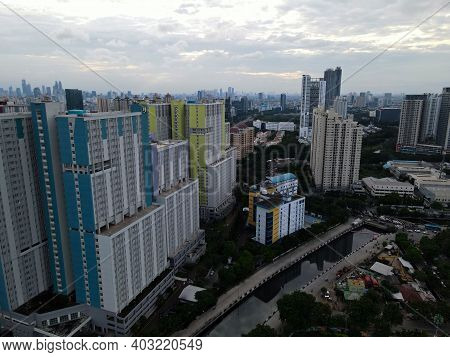 Aerial Drone View Of Modern Apartment Building In Jakarta Central Business District With Jakarta Cit