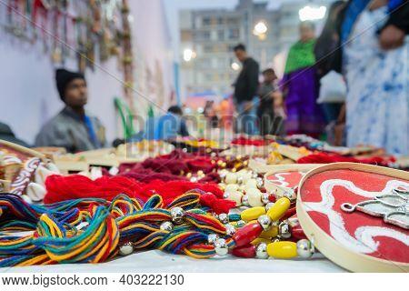 Kolkata, West Bengal, India - 31st December 2018 : Indian Man Selling Coloutful Handmade Jewelleries