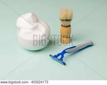 Plastic Disposable Razor, Foam And A Shaving Brush For Shaving. Set For Care Of A Man's Face.