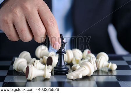 Businessman Finger Hands Control Chess King To Success Position On Competition Business Game With Fa