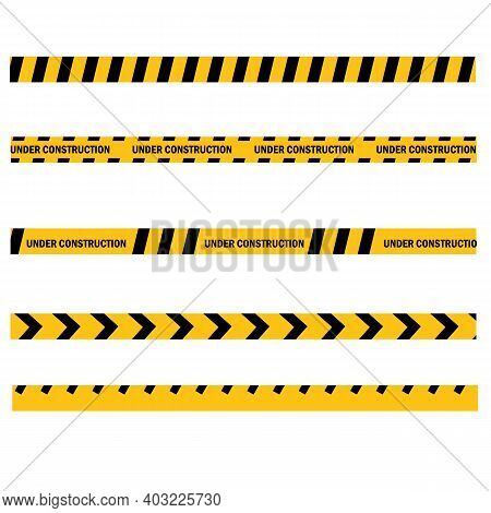 Caution Yellow Tape Construct Warning Line On White Background. Website Developed And Not Temporaril
