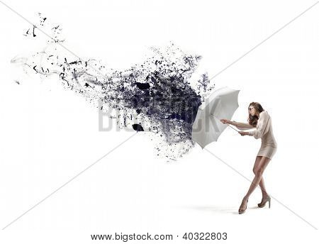 Beautiful woman in white with sunglasses repairing a large splash of black paint