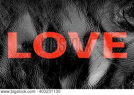 Black Background Texture Patent Leather, Inscription Love In Large Red Letters. Valentine's Day Febr