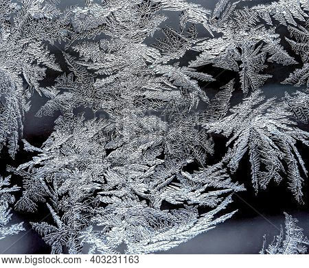 Texture Of Frosty Patterns On The Winter Window