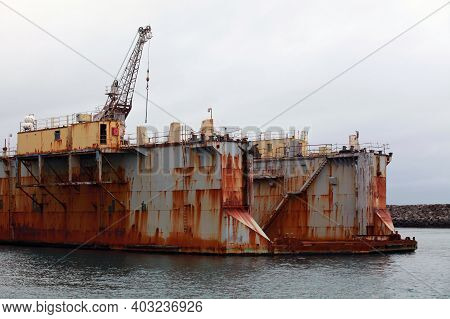 Old Rusty Floating Dry Dock Fragment. Dry Docks Are Used For The Construction, Maintenance, And Repa