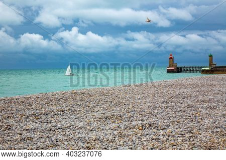 View Of Famous Fecamp Beach, Lighthouse And Boat, Normandy, France